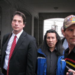 "Glenn Stoddard, Art ""Little Big Man"" Sheggone, and drummer Sam Morris outside the capitol."