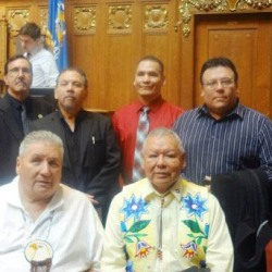 "Leaders of the Wisconsin Indian Tribes. From Left: Left is Stewart Bearhart, (St. Croix) Bob Chicks, (Stockbridge-Munsee) Ed Delgago, (Oneida) Craig Corn, (Menominee) Mike Wiggins, (Bad River Ojibwe) Mic Isham, (Great Lake Indian Fish and Wildlife Commission) front is Tom Maulson (Lac du Flambeau) and Harold ""Gus"" Frank, (Forest County Potawatomi)"