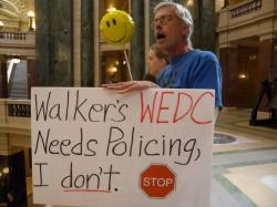 """Walker's WEDC needs Policing, I don't"" from Solidarity Sing Along 9/27/2012 at WI State Capitol. Photo: Lisa Wells"