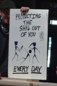 Sign held at today's Solidarity Sing Along. Photo by Rebecca Kemble