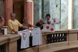 Three of these citizens received citations for holding up signs and t-shirts during a Red Cross blood drive in September. Signs and t-shirts are extremely protected First Amendment speech and all have requested jury trials. Photo credit:  Leslie Amsterdam