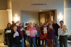 Four defendants and their supporters stand outside Courtroom 1A at the Dane County courthouse after initial appearances for charges stemming from arrests at the WI Capitol during September. Valerie Walasek (front row, pink sweater) traveled from Florida for her mandatory appearance, and her charges for accidentally dropping a balloon and resisting arrest were dropped at the last minute. Two others who received state misdemeanor charges during the arrest of a disabled veteran in September also had their charges dismissed. The remaining defendant, Ted Voth Jr., entered not guilty pleas for Disorderly Conduct and Obstructing Arrest for charges stemming from the same September incident.