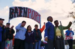 The Reverend Al Sharpton stands alongside Dot, a longtime Sensata Technologies worker and other citizens arrested in recent civil disobedience actions related to Sensata outsourcing all jobs to China by the end of the year. The encampment set up outside the Freeport, Illinois plant is receiving national attention. Learn more at Bainport.com. Photo: Leslie Amsterdam