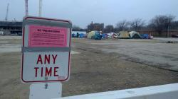 This No Trespassing sign has been posted at the current Occupy Madison location on the 800 block of E. Washington Avenue, directly east of last year's encampment. On Thursday, Madison police informed campers that they must leave by 3pm Sunday or risk eviction and a Trespassing citation. Occupy Madison is meeting on Saturday at the site to discuss moving plans, as there is no legal place for these people to reside while they seek permanent housing solutions. Photo by Brenda Konkel