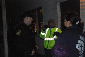 CPO Andrew Hyatt delivers citations to 2 individuals at 8:30pm on 11/27/12. Photo: Lisa Wells.
