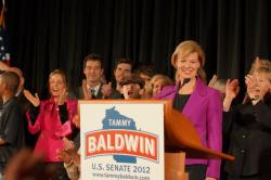 Tammy Baldwin takes in the moment after her victory speech at Monona Terrace in Madison Tuesday night. Baldwin becomes the first woman elected to the US Senate from Wisconsin and the first openly gay member to serve in the Senate. She defeated former Wisconsin governor Tommy Thompson to continue representing the people of Wisconsin in Washington DC.