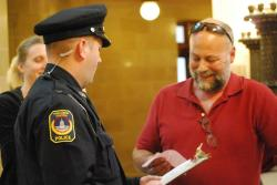 Bart Munger receives his citation with a smile from Officer Andrew Hyatt. Photo: Lisa Wells