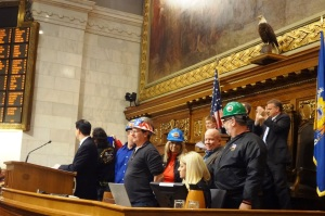Walker invited hard hat wearing folks from northern Wisconsin to join him at the podium during his State of the State address promoting a new mining deregulation bill.