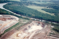 The Flambeau Mine (a Kennecott/Rio Tinto project) operated on the banks of the Flambeau River near Ladysmith, Wisconsin in the mid-1990s. This photo was taken in 1994 when the river flooded during heavy rains and came within 20 horizontal feet and 4 vertical feet of spilling into the mine pit. (Photo by Bob Olsgard of Sarona, WI, September 17, 1994)