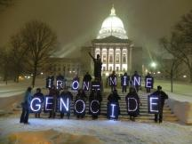 Overpass Light Brigade, Madison WI on the eve of the legislature hearing the mining bill