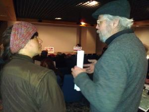 Local resident Sarah Martinez talks with Ashland City Council member Richard Ketring at the Bad River news conference.