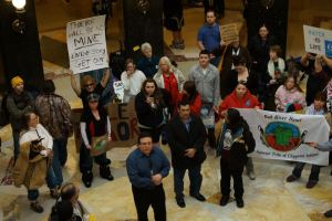 "Bad River Tribal Chair Mike Wiggins Jr. addresses the crowd in the rotunda on February 27. His message was, ""There will be no mine."""