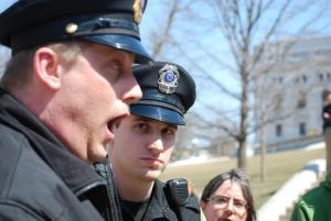 Capitol Police Lieutenant David Davis reacts to the recitation. Photo by Lisa Wells.