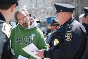 Capitol Police Officer Brian Henry attempts to deliver citations. Photo by Lisa Wells.