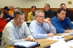 GTac engineer Tim Myers, lobbyist Bob Seitz and CEO Bill Williams in front of the Iron County Board.