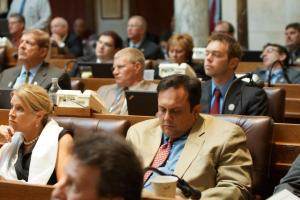 While some GOP legislators paid attention to the Dalai Lama, Rep Kleefisch played with his phone and Rep Tranel slept. Photo by Leslie Amsterdam