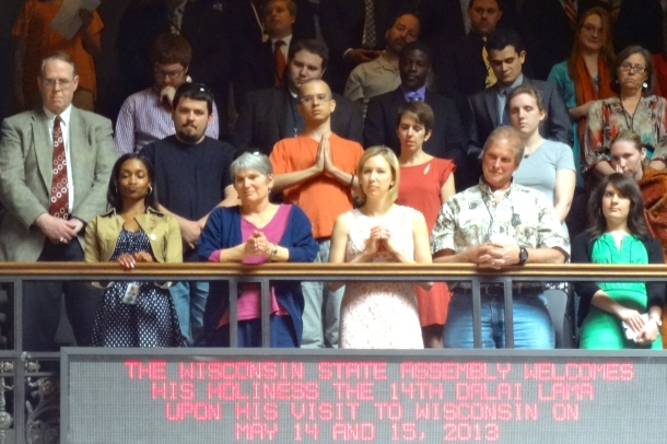 Visitors in the public gallery stand for His Holiness the 14th Dalai Lama. Photo by Rebecca Kemble