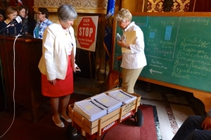 Rep. Janet Ringhand (D-Janesville) and Rep. Sondy Pope (D-Middleton) with a wagon full of 16,809 signatures.