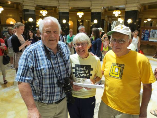 WI Sen Bob Jauch, Joan and Tom Kemble after the Kembles were arrested for singing in the WI Capitol. Photo: Leslie Amsterdam