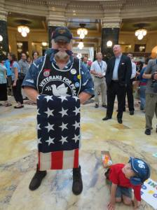Lars Prip, A USMC Vietnam Veteran with his young frind Aidan in the rotunda of WI Capitol.