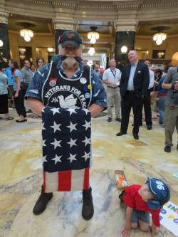 Lars Prip, A USMC Vietnam Veteran with his young frind Aidan in the rotunda of WI Capitol. Photo: Leslie Amsterdam