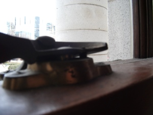 Headless screws driven into window hardware at the Capitol to prevent access during lockdown.