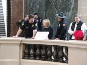 Capitol Police and Wisconsin State Patrol officers harass a peaceful citizen holding a sign.