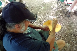 Camp host Melvin Gaspar sewing a birchbark basket with deer sinew.
