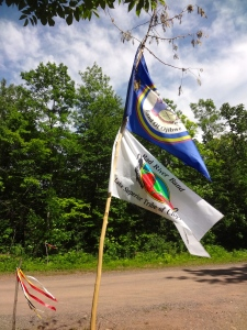 Lac Courte Oreilles and Bad River Bands of Lake Superior Chippewa sovereign flags at the entrance of the LCO Harvest and Education Camp.