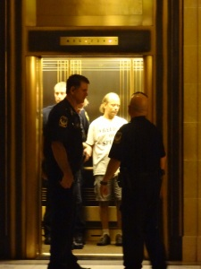 Capitol police officers arresting a man for holding a sign in September, 2012.