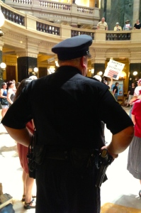 Officer Mitch Steingraber patrols the Solidarity Sing Along on July 16, 2013.