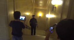 Two young boys tape arrests in Wisconsin Capitol.