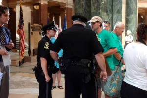 Veteran for Peace Norman R. Aulabaugh was part of a group of veterans being told they would be arrested if they observed the Solidarity Sing Along at the State Capitol. Photo: Rebecca Kemble