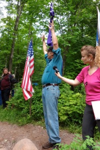 Paul DeMain speaks at the flag installation ceremony at the LCO Harvest and Education Camp, July 30, 2013. Photo by Rebecca Kemble