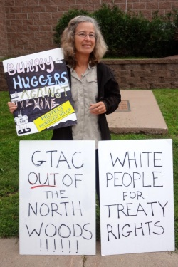 LCO Harvest Camp supporter outside of the Iron County Board meeting on July 30, 2013. Photo: Rebecca Kemble