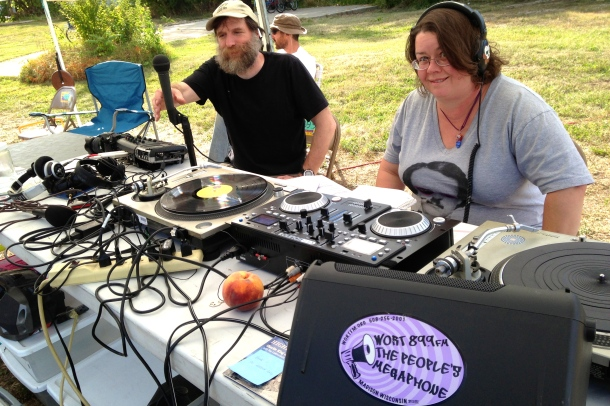 WORT station manager Norman Stockwell and DJ Bad Sister Heidi staffing the remote radio station. Photo by Rebecca Kemble