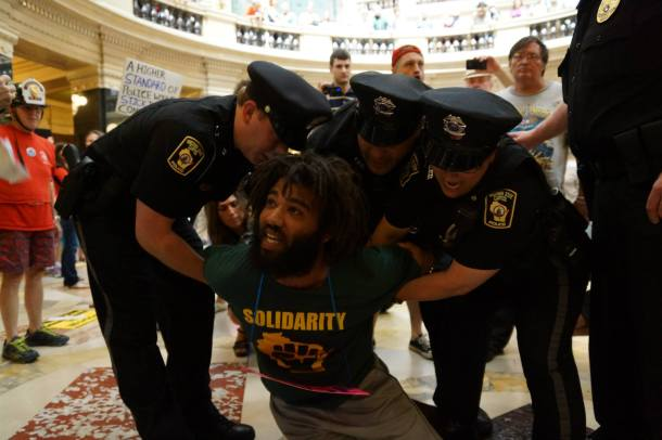 August 26, 2013 CJ Terrell is subdued using pain compliance techniques. He was arrested for singing at the WI Capitol without a permit.