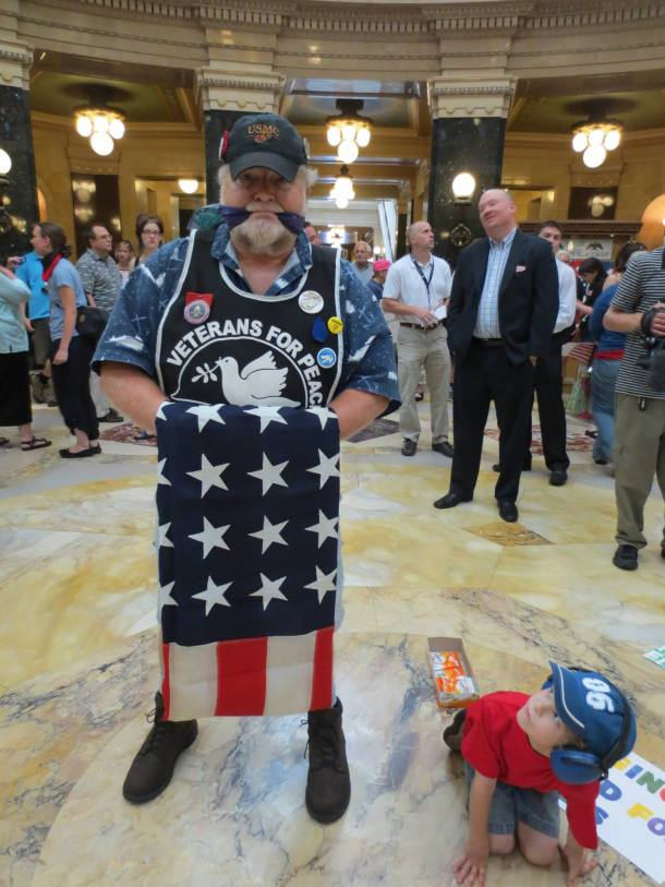 July 25, 2013 Lars and friend before the Veterans For Peace activist was arrested with his flag falling to the ground and stepped on by Capitol police officers.