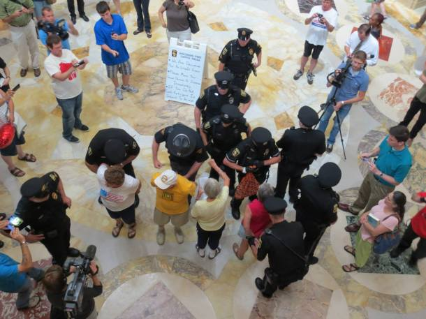 July 24, 2013 Capitol Crackdown arrests for singing begin over the noon hour with many singers refusing to stop singing.