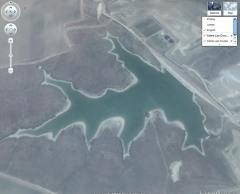Sulfuric acid holding pond at Cobre Las Cruces. Google Earth.
