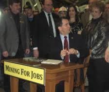 Leslie Kolesar is seen behind Walker at the Act 1 bill signing.
