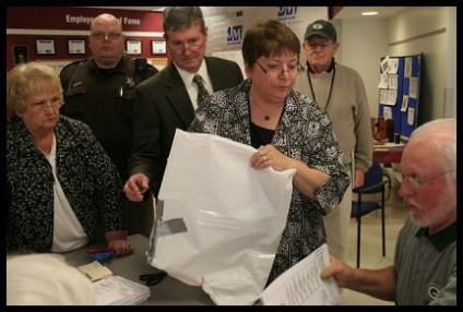 Duct taped ballot bags from the Village of Menomonee Falls are presented to the election judge.