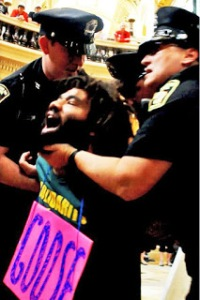 Peaceful protester being arrested at Capitol. Photo: Erin Proctor
