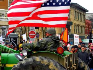Wisconsin farmers drive their tractors to the Capitol to protest Walker's budget, March 2011. Photo: Michael Matheson