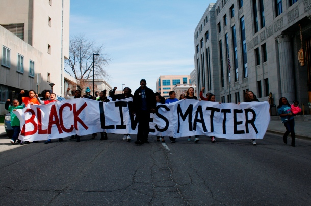 Eric Upchurch II of Young, Gifted & Black Coalition leads the march to the offices of Dane County DA Ismael Ozanne.