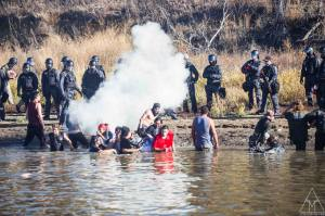Water protectors being tear gassed. Photo: Adam Alexander Johansson