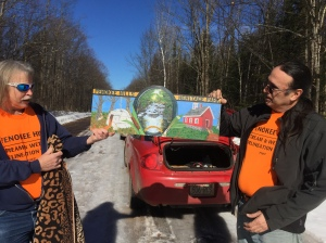 Wildlife biologist Gerggory Jennings shows off a new sign he created for the Penokee Hills Heritage Park Facebook Page, with Paul DeMain.